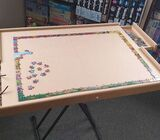 Jigsaw puzzle or craft board with drawers